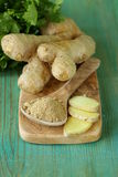Ground ginger in a wooden spoon Stock Photos