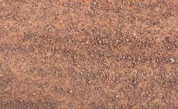 Ground and gravel. On the road in a rural community Stock Photos