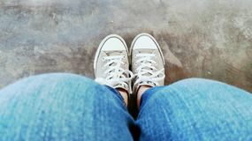 Gray shoes blue jeans stock photography