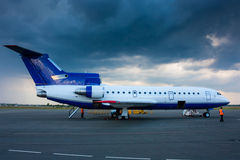 Ground handling aircraft on the airport apron. In clody weather Stock Image