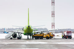 Ground handling of airliner. In cold winter airport Stock Images