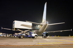 Ground handling of airliner in the night Stock Image