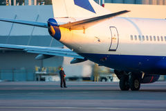 Ground handling. Airplane parked at the airport and preparation for next flight stock photo