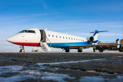 Ground handling of private airplane. In a cold winter airport Royalty Free Stock Image