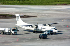 Ground handling of turboprop plane. On the airport apron royalty free stock image
