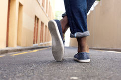 Ground level man standing on street Royalty Free Stock Images