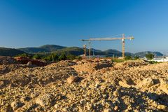 Ground level of construction site with crane Royalty Free Stock Photo