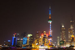 Ground level shot of Shanghai Pudong skyline by night. A long shutter with the beautiful neon lights of the city. Looking over the Stock Images