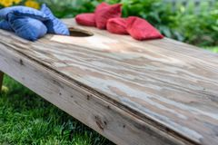 ground level view of cornhole board and bags game board Stock Photo