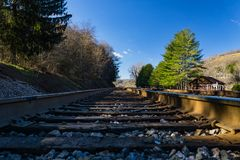 Ground Level View of Railroad Tracks in the Mountains. Ground level view railroad tracks running through the mountains located in rural southwest Virginia, USA royalty free stock photography