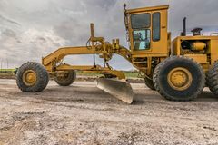 Ground leveling machine to build a road stock photography