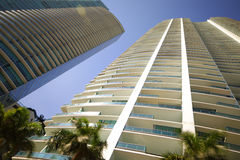 Ground low angle view of highrise buildings on blue sky Royalty Free Stock Photos