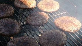 Ground meat cooking on barbecue grill stock video footage