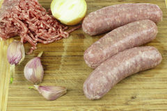 Ground meat and raw sausage. Fresh ground meat and raw sausage Royalty Free Stock Photo