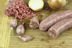 Ground meat and raw sausage Royalty Free Stock Photo