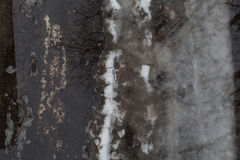 Ground melting snow dark gray puddle. Winter melting snow dark gray background reflection in water wallpaper Stock Photos