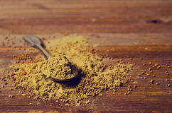 Ground mustard powder. On a wooden background. Selective focus Stock Images