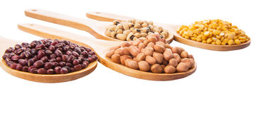 Ground Nut, Bean And Lentils III. Ground nut, dal lentils, black eye bean and adzuki bean on wooden spoon Royalty Free Stock Image