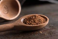 A single teaspoon of ground nutmeg stock image