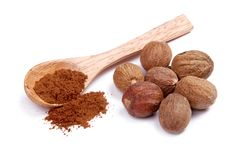 Ground nutmeg in a wooden spoon Royalty Free Stock Photo
