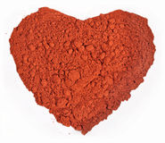 Ground paprika in the form of heart on a white Royalty Free Stock Photos