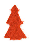 Ground paprika isolated in christmas tree shape Stock Photo
