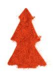 Ground paprika isolated in christmas tree shape stock photo