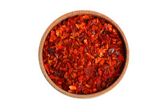 Ground paprika pepper. In wooden bowl isolated on white background royalty free stock images