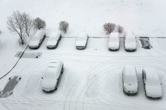 Ground parking cars after snowfall, view from above. Stock Photography