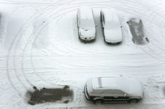 Ground parking cars after snowfall. Stock Image