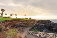 Ground path with handrails along rocky coastline.  royalty free stock photos