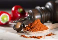 Ground pepper mill red pepper on a table paprika and pepper mill. Ground pepper mill red pepper on a table with paprika and pepper mill royalty free stock images