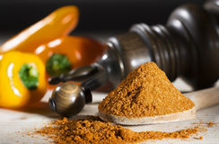 Ground pepper mill yellow pepper on a table paprika and pepper mill. Ground pepper mill yellow pepper on a table with paprika and pepper mill royalty free stock photo