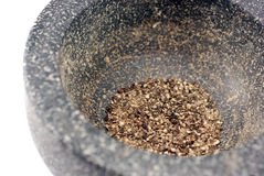 Mortar with ground black peppercorns  Stock Images