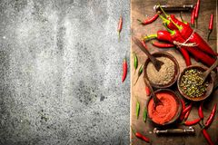 Ground red hot chili peppers in a bowl. On a rustic background Stock Image