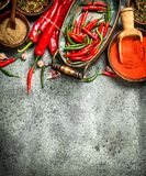 Ground red hot chili peppers in a bowl. On a rustic background Royalty Free Stock Photos