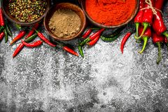 Ground red hot chili peppers in a bowl. On a rustic background Royalty Free Stock Image