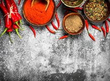 Ground red hot chili peppers in a bowl. On a rustic background Royalty Free Stock Photo