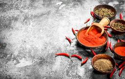 Ground red hot chili peppers in a bowl. On a rustic background Stock Photo