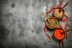 Ground red hot chili peppers in a bowl. On a rustic background Royalty Free Stock Photography