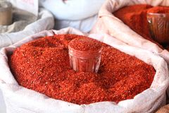 Ground red hot pepper. Fragrant spice - ground red hot pepper . in the market in a big bag stock photos