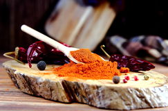 Ground red pepper in spoon. On a wooden Board stock photo