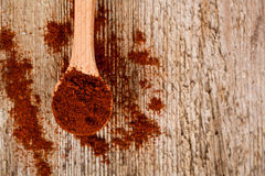 Ground red pepper in wooden spoon Stock Images