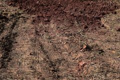 Ground reddish brown with and the wheels of the tractor. royalty free stock photo