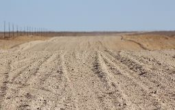 Ground road through the desert royalty free stock photography