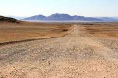 Ground road through the desert royalty free stock photo