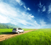 Ground road and car. Ground road and white blurred car Stock Images