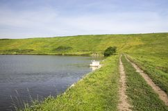 Ground road on the dam Royalty Free Stock Image
