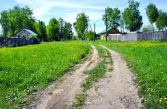 Ground road in small russian village Royalty Free Stock Photo