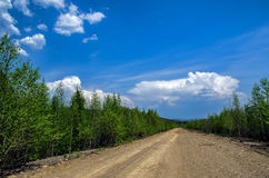 Ground road under clouds Stock Photo